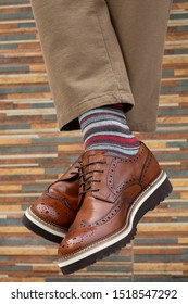fashionable men's shoes with feet in socks