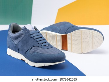 Fashionable men's sneakers on a colorful artistic background. Men's Clothing