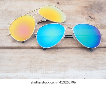Fashionable mirror sunglasses on wooden background