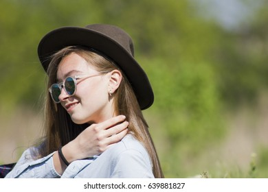 Fashionable model with long hair, in cool stylish summer clothes