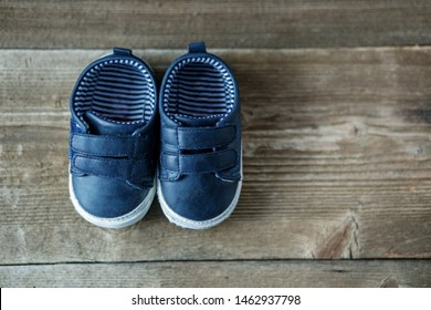 Fashionable modern baby shoes. Flat lay. Concept of care, baby, motherhood.