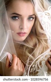 Fashionable and modern bride, beautiful blonde girl, smiling with happiness and love