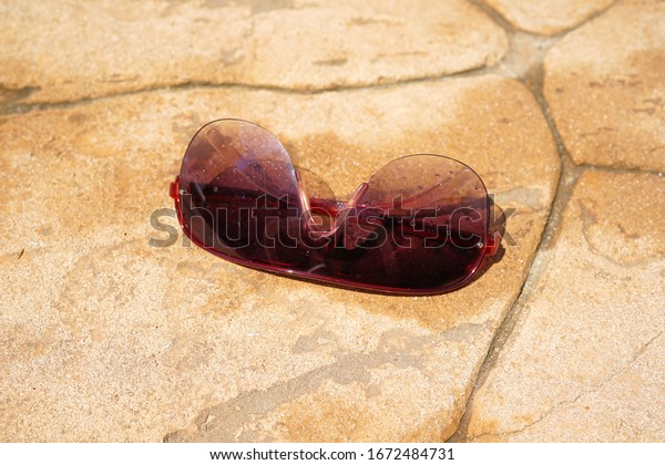 fashionable and modern sunglasses lie on the stone