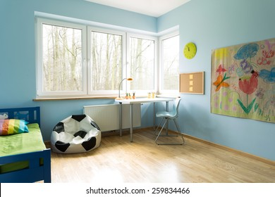 Fashionable new kid's room with wooden floor
