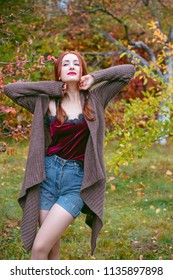 Fashionable nice woman wear casual style outerwear, pretty face red natural hair spring autumn collection fashion clothes outdoor