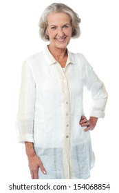 Fashionable old woman posing in style over white
