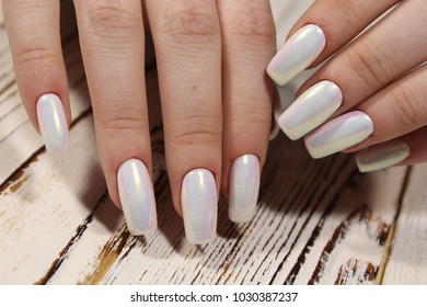 fashionable pearl manicure of nails on a beautiful textural background