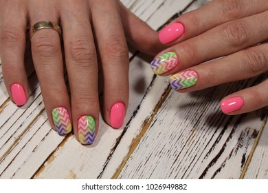 fashionable pink nails with a design of multi-colored pattern