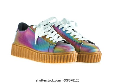 Fashionable platform sneakers with a holographic rainbow design.