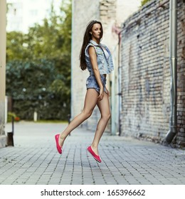 Fashionable portrait of a beautiful girl in jump