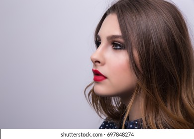 Fashionable portrait of a girl model with red lips.