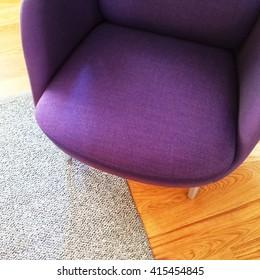 Fashionable Purple Armchair On Wooden Floor. Modern Furniture.