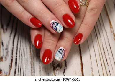 fashionable red manicure on long beautiful nails