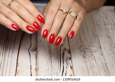 fashionable red manicure on white textural background