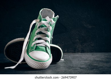 Fashionable retro style sneakers on the dark background