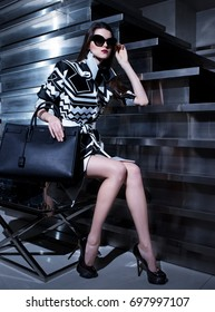 Fashionable shooting of luxury clothes, professional model. Studio photography.