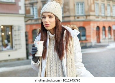 fashionable smiling woman in winter clothes