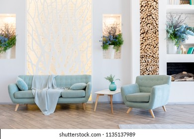 Fashionable spacious apartment with a stylish design in green, grey and white pastel colors with big window and decorative walls