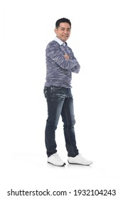 Fashionable and stylish man. Full body Handsome young man in jeans with arms crossed  on white background