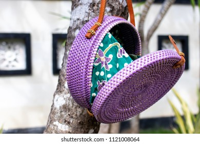 Fashionable stylish rattan bag outside. Tropical island of Bali, Indonesia. Rattan handbag.