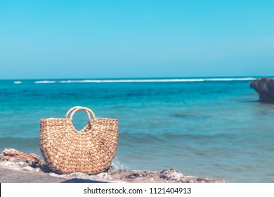 Fashionable stylish straw bag outside. Tropical island of Bali, Indonesia. Rattan handbag.