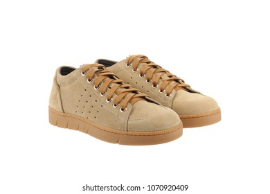 Fashionable suede sneakers with unique design. Sport  beige shoes.  Expensive footwear isolated on white background