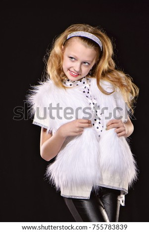 2e092b0f66ce Fashionable teenage girl in a white fur coat on a black background.  Textile