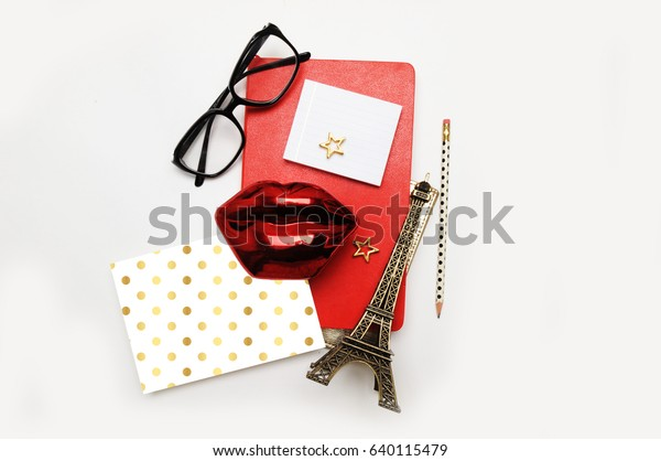 Fashionable travel background, Paris, Red lips with red notebook, flat lay and top view. gold accessory. Polka dots pattern