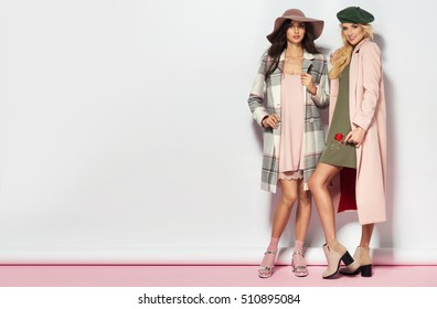 Fashionable two women in coat and nice dress. Fashion autumn winter photo