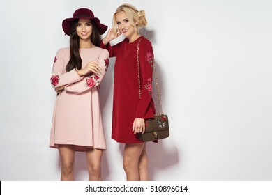 Fashionable two women in nice dresses. Fashion autumn winter photo