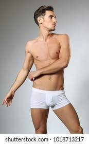 fashionable and undressed young man in  white  underwear with stylish
