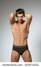 fashionable and undressed young man in  white and black  underwear with stylish