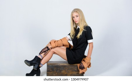 Fashionable uniform. Vintage and retro style. Vintage fashion concept. Girl blonde wear elegant black dress. Formal uniform elite school college or housemaid. Vintage model. Elegance in simplicity.