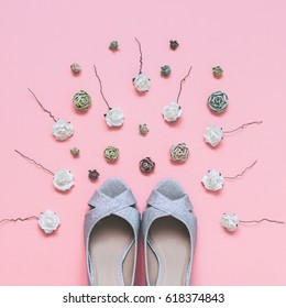 fashionable wedding shoes with shiny effect and roses of different sizes and colors. minimal flat lay.