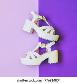 fashionable white platform sandals on ultra violet background. minimal trend