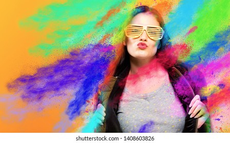 Fashionable woman with attitude with coloful party splashes