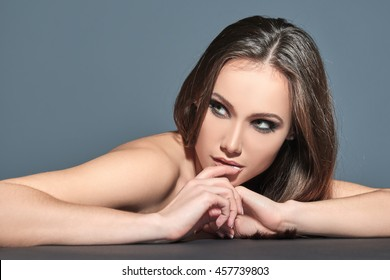 Fashionable woman. Beautiful female face. Woman of high society. Heartbreaker. Beauty woman. Portrait of amazing young fashion woman posing at studio.