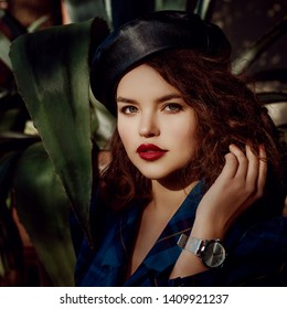 Fashionable woman with dark red lips makeup, wearing trendy leather beret, silver wrist watch