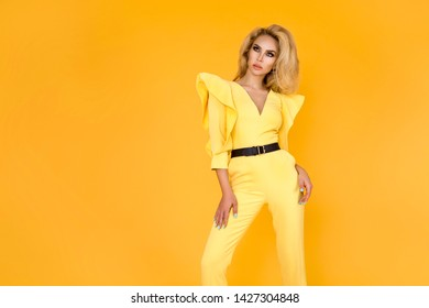 Fashionable woman in nice yellow jumpsuit, shoes and accessories. Fashion spring summer photo - Image