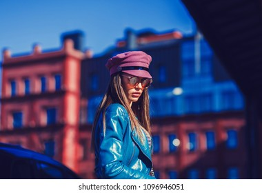 fashionable woman posing in urban settings