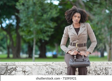 Fashionable woman with a purse