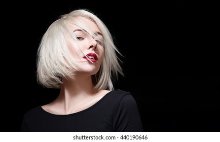 Fashionable woman with red lipstick and short hair on black background