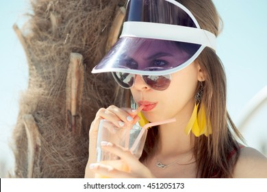 fashionable woman in red swimsuit , cap, sunglasses