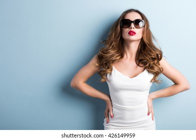 Fashionable woman in sunglasses.