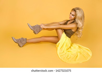 Fashionable woman in trendy yellow dress, shoes and accessories. Fashion spring summer photo. Country girl - Image