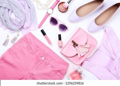 Fashionable women's clothes with makeup cosmetics and accessories on white background