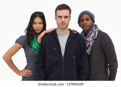Fashionable young friends looking at camera on white background