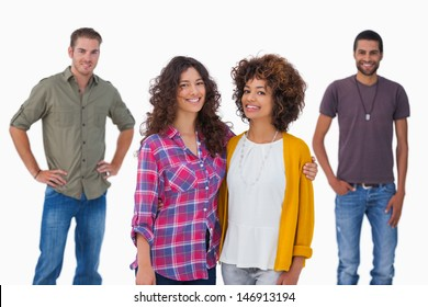 Fashionable young friends smiling at camera on white background