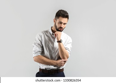 Fashionable young man on light background