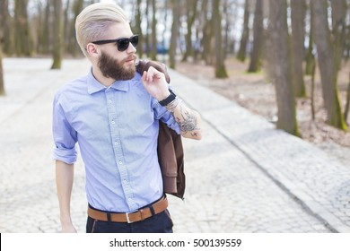 Fashionable young man representing the new generation's hipster style.